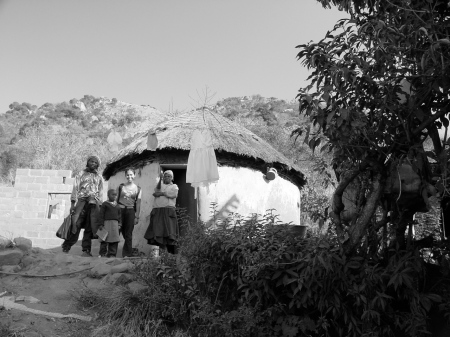 With a sweet family I stayed with in a tiny village in the hills of Swaziland.
